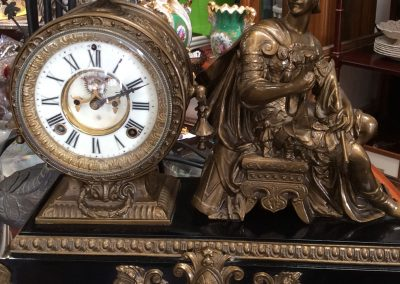 Brass Skelton Clock with roman figurine